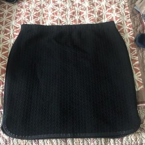 Quilted black just below knee skirt